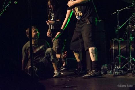 "At the heart of it all: Napalm Death vocalist ""Barney"" Greenway offers a helping hand to a downed crowdsurfer."
